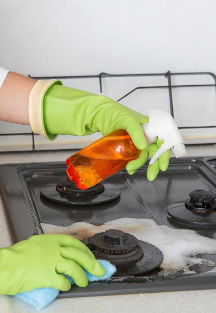 how to clean a gas stovetop by hellamaid